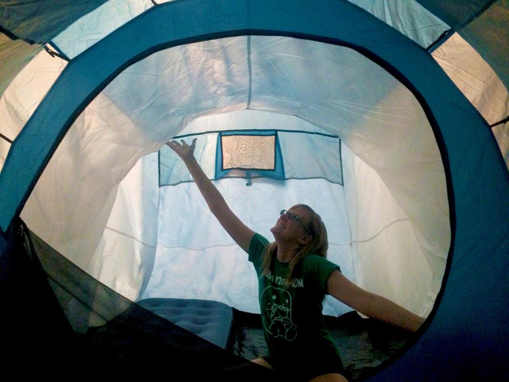 Lindsay sitting in her blue tent :: I've Been Bit! Travel Blog