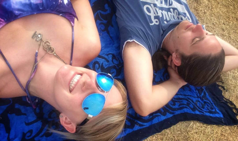 Lindsay and Robin Napping in a Quiet Corner of the Festival Grounds :: I've Been Bit! Travel Blog