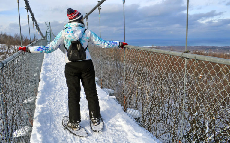 Lindsay Snowshoeing the Suspension Bridge at Scenic Caves in the Winter :: I've Been Bit! Travel Blog