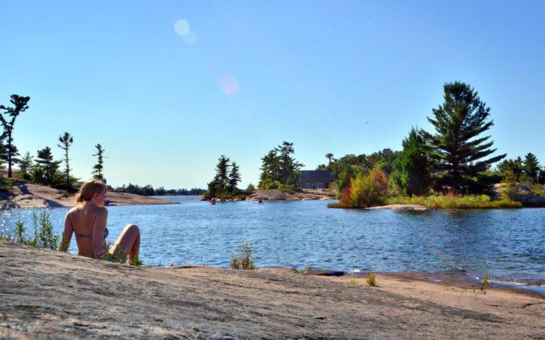 Lindsay Sitting on Canadian Shield Shoreline :: I've Been Bit! Travel Blog