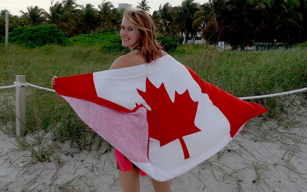 Lindsay Holding a Canadian Flag Towel :: I've Been Bit! Travel Blog