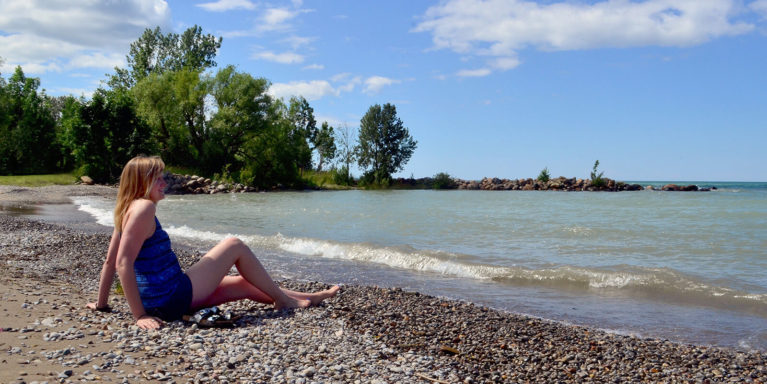 Lindsay Sitting on the Shores of Lora Bay, part of Georgian Bay Ontario Canada :: I've Been Bit! Travel Blog
