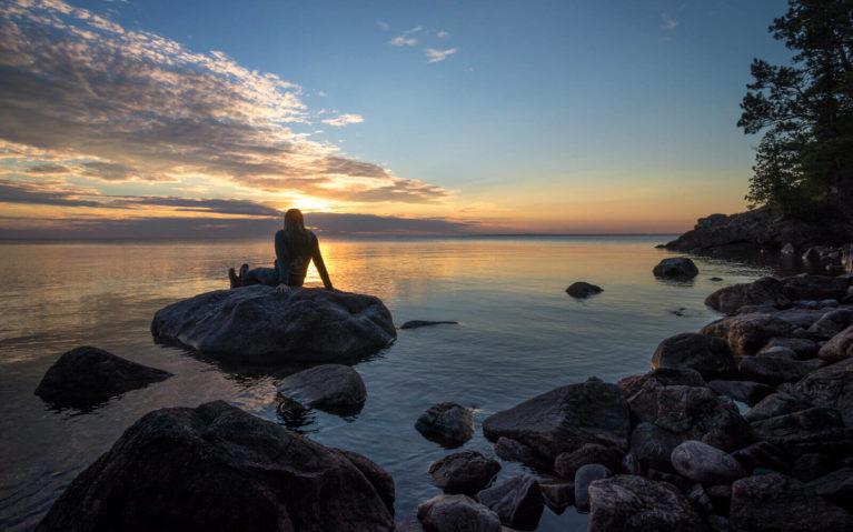 Lindsay Sitting on a Rock Along Lake Superior