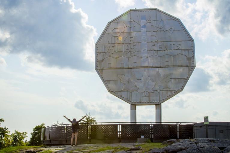 Lindsay Standing in Front of the Big Nickel in Sudbury :: I've Been Bit! Travel Blog