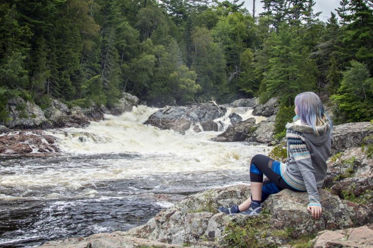 Lindsay Sitting Beside Chippewa Falls :: I've Been Bit! A Travel Blog