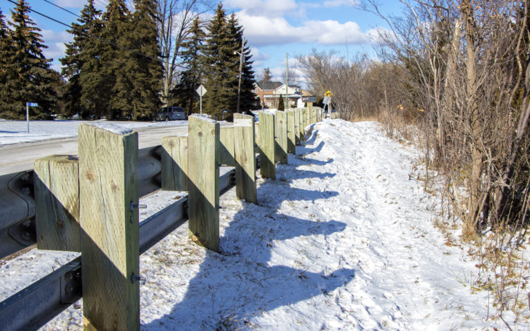 Snowy Trail Beside a Road Barrier :: I've Been Bit! Travel Blog