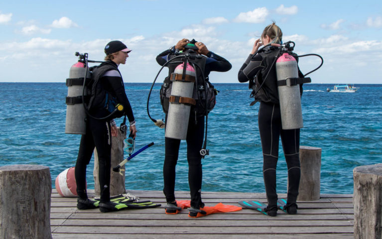 Three Scuba Divers Standing on Dock in Cozumel Mexico :: I've Been Bit! A Travel Blog