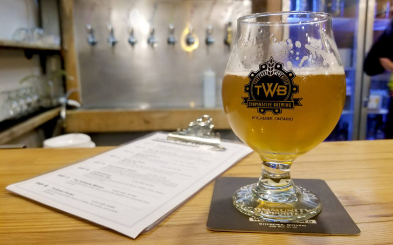 TWB Brewing's Syncopation Saison in Front of the Bar :: I've Been Bit! Travel Blog