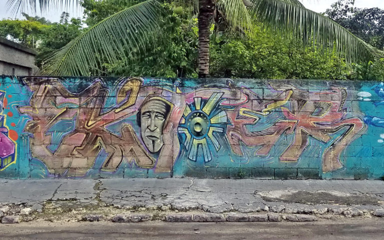 Man with Shield Mural in Cozumel Mexico :: I've Been Bit! Travel Blog