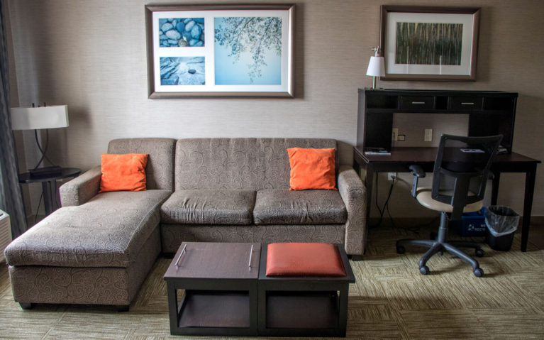 Sofa and Desk inside the Staybridge Suites Hotel Room in Hamilton, Ontario :: I've Been Bit! Travel Blog