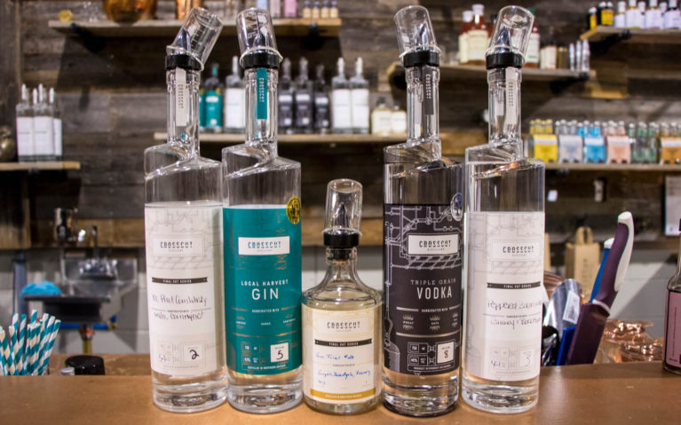 Bottles of Alcohol Lined Up at Crosscut Distillery in Sudbury, Ontario :: I've Been Bit! Travel Blog