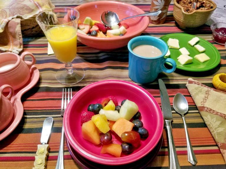 Breakfast Spread on Table including Fruit, Yoghurt, Granola, Coffee and Juice :: I've Been Bit! Travel Blog
