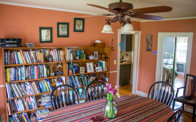 Dining Room with Table, Ceiling Fan and Huge Bookshelf :: I've Been Bit! Travel Blog