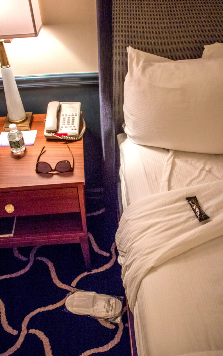 View of the Bed with Chocolate, Slippers and Bottle of Water On It :: I've Been Bit! Travel Blog