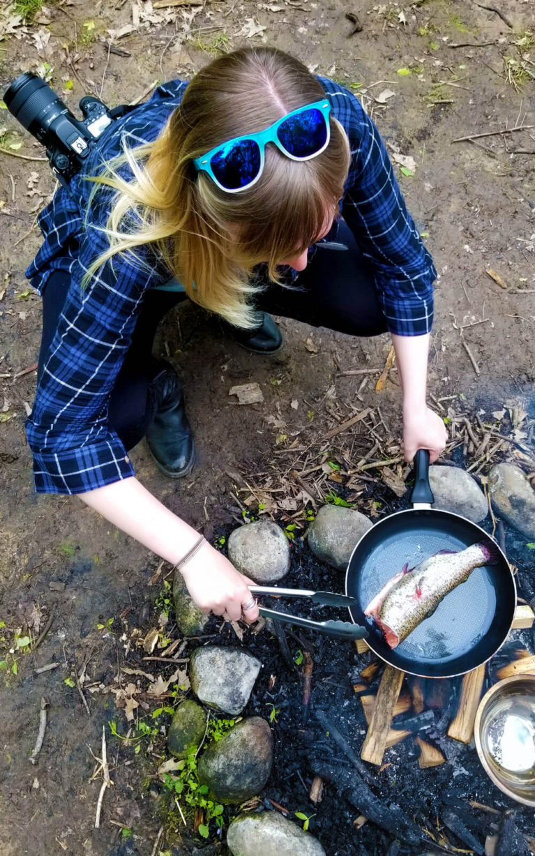 Lindsay Cooking a Trout over the Campfire in the Woods :: I've Been Bit! Travel Blog