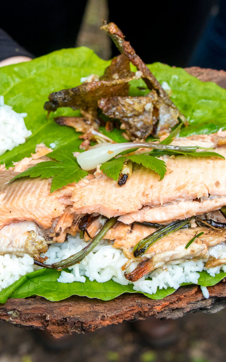 Cooked Trout with Leeks on a Bed of Rice Sitting On Top of a Leaf :: I've Been Bit! Travel Blog