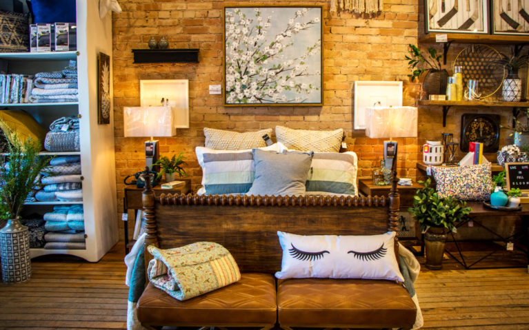 Example Bedroom Set Up with Exposed Brick Wall and Beautiful Furnishings at Jillian's Home Decor Store in Mitchell Ontario Canada :: I've Been Bit! Travel Blog