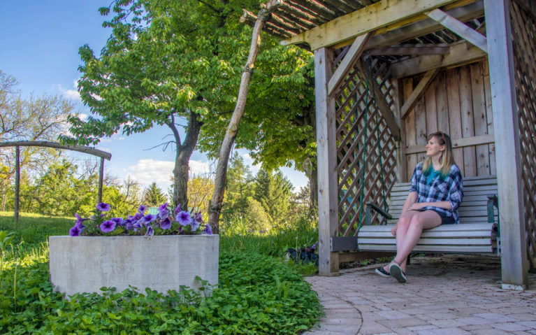 Lindsay Taking a Moment to Enjoy the Country Air in Perth County on Organic Oasis' Pollinator Patio :: I've Been Bit! Travel Blog