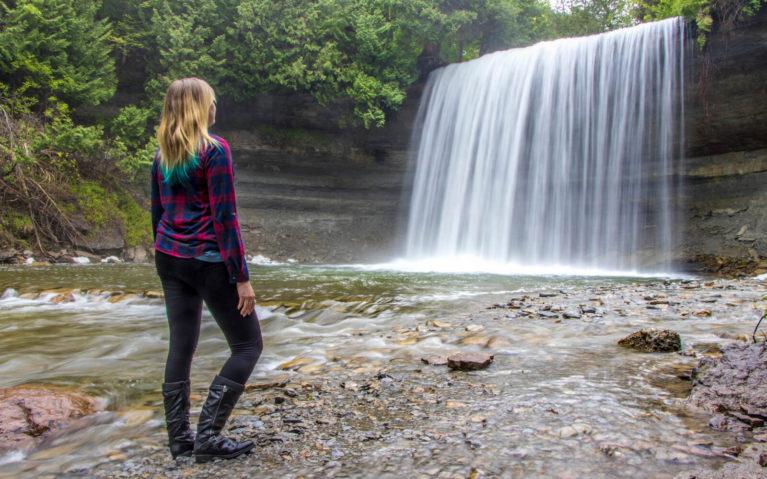 Lindsay Standing At the Base of Bridal Veil Falls on Manitoulin Island, Ontario :: I've Been Bit! Travel Blog