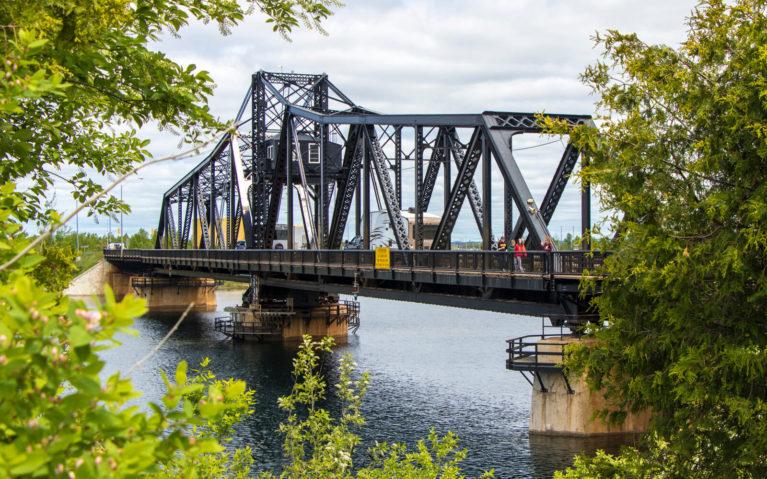Little Current Swing Bridge Framed by Trees :: I've Been Bit! Travel Blog