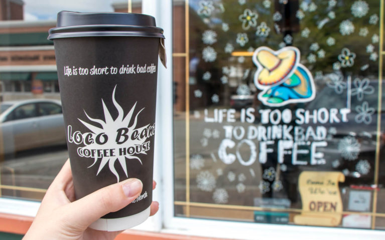 Cup With Loco Beanz Logo In Front of Little Current Store Front :: I've Been Bit! Travel Blog