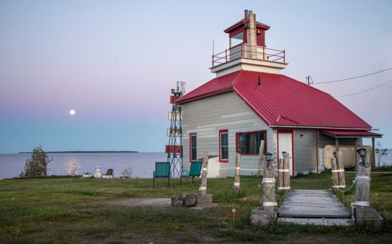 McKay Lighthouse at Sunset with the Moon in the Sky On the First Night of our Fishing Adventure in Northern Ontario :: I've Been Bit! Travel Blog