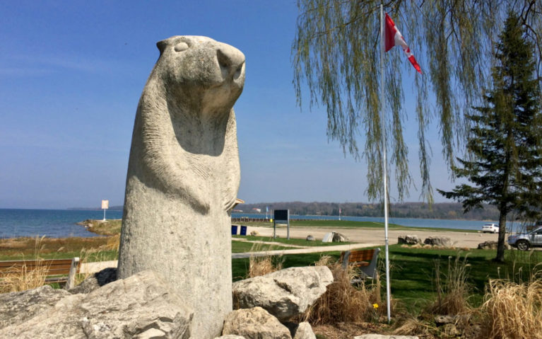 View of Bluewater Park Beside the Wiarton Willie Monument with the Canadian Flag in the Background :: I've Been Bit! Travel Blog