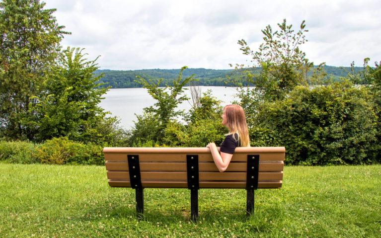 Lindsay Sitting on a Bench in Moraine State Park :: I've Been Bit! Travel Blog