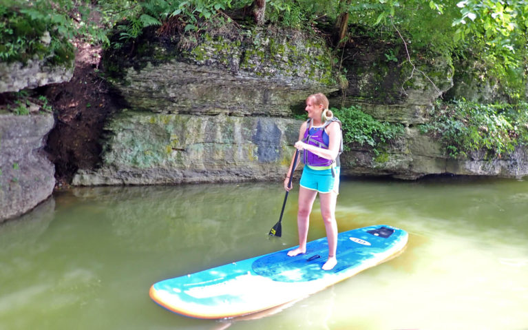 Lindsay on a Paddleboard in Moraine State Park with SurfSUP Adventures :: I've Been Bit! Travel Blog