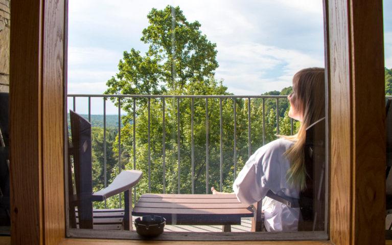 Lindsay Sitting on Her Balcony at the Seven Springs Mountain Resort :: I've Been Bit! Travel Blog