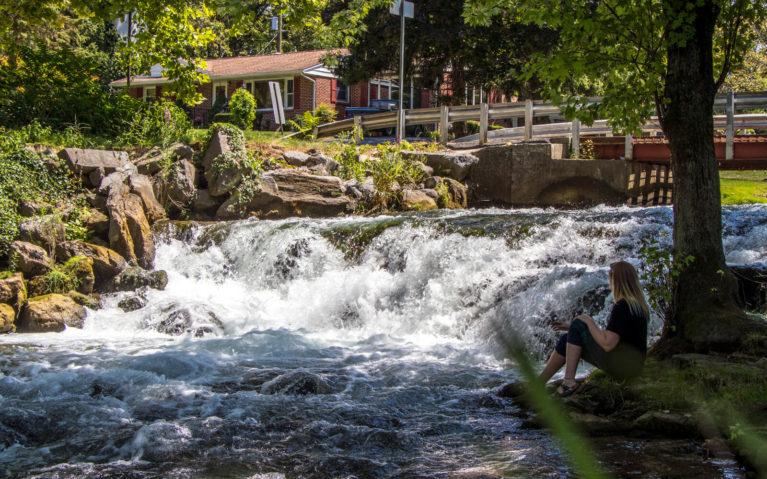 Lindsay Sitting in Front of Letort Falls :: I've Been Bit! Travel Blog