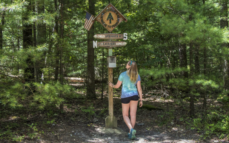 Lindsay Standing at the Midpoint of the Appalachian Trail :: I've Been Bit! Travel Blog