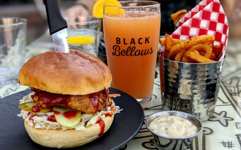 Fried Hot Chicken Sandwich beside a Grapefruit Radler with Curly Fries and their Garlic Parmesan Dip :: I've Been Bit! Travel Blog