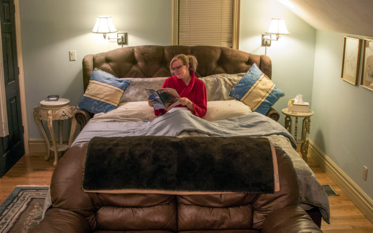 Lindsay Reading a Magazine in Bed :: I've Been Bit! Travel Blog
