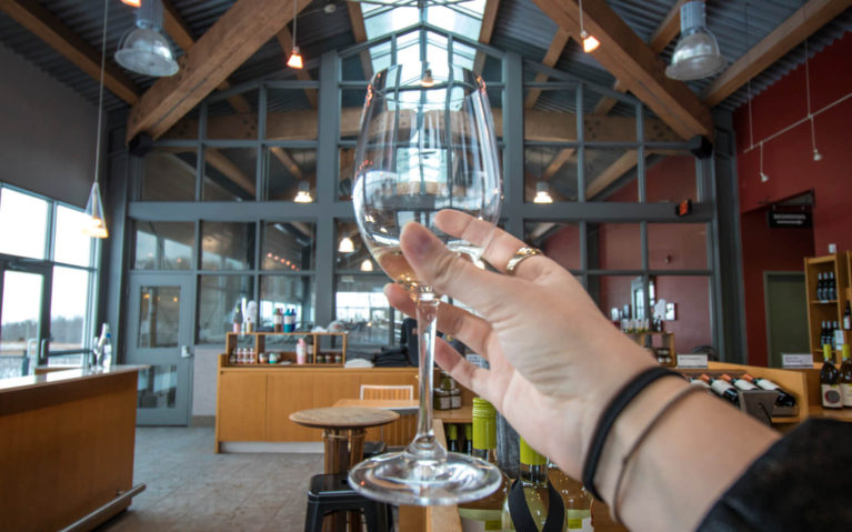 Hand Holding a Glass Inside of Fielding Estates Winery :: I've Been Bit! Travel Blog
