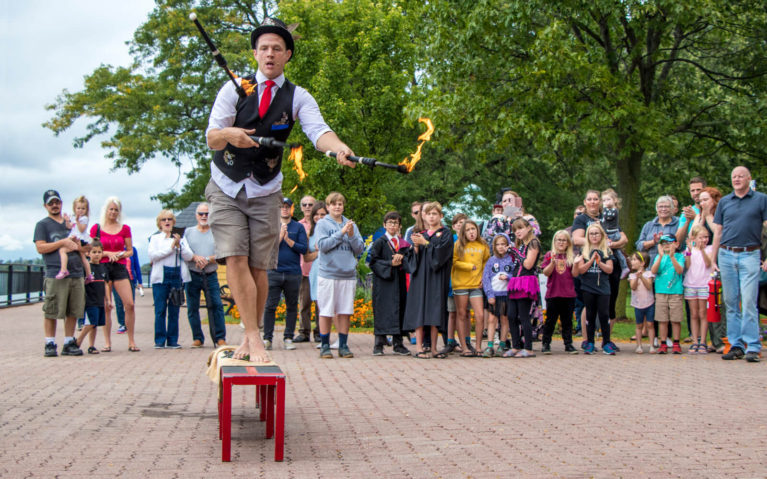 Busker stepping on Glass Shards while Juggling Flaming Batons at the Amherstburg Uncommon Festival :: I've Been Bit! Travel Blog