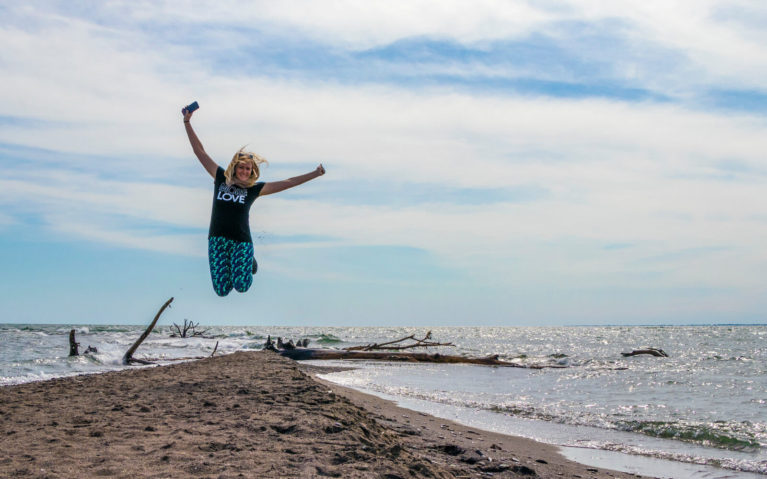Lindsay in Mid Air at The Tip in Point Pelee National Park :: I've Been Bit! Travel Blog