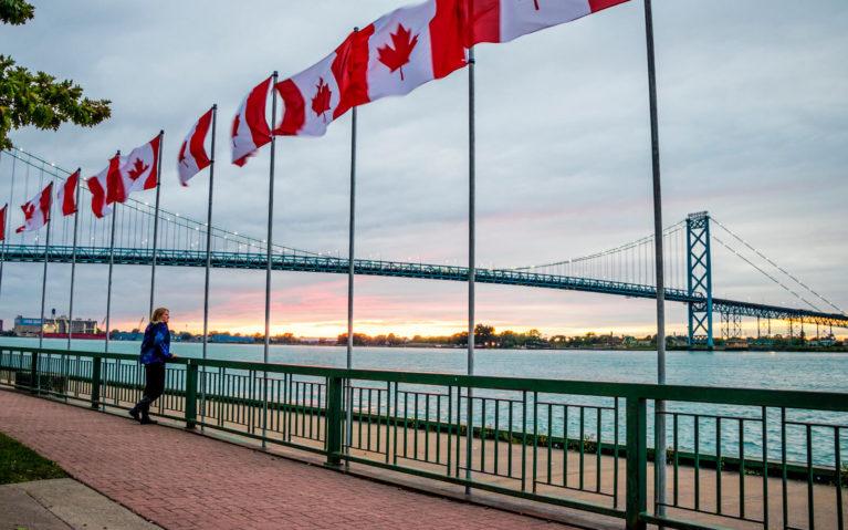 Lindsay on the Riverfront Trail Looking Out at the Ambassador Bridge :: I've Been Bit! Travel Blog