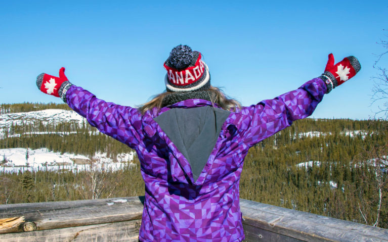 Lindsay with Her Arms Outstretched Wearing a Canada Hat and Mitts :: I've Been Bit! Travel Blog