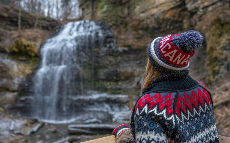 Lindsay Wearing a Canada Toque Staring at a Waterfall :: I've Been Bit! Travel Blog