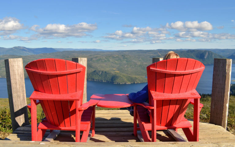 Lindsay Sitting on the Parks Canada Chairs in Gros Morne National Park :: I've Been Bit! Travel Blog