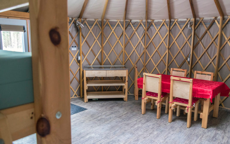 View inside a Yurt in Killarney Provincial Park with Table, Counter and Bed :: I've Been Bit! Travel Blog