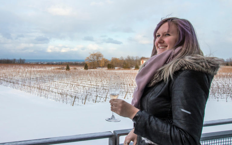 Lindsay with a Glass of Wine in Hand Overlooking a Vineyard :: I've Been Bit! Travel Blog