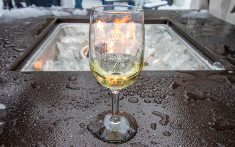 Tasting Glass of Riesling in Front of Fire Place in Niagara-on-the-Lake :: I've Been Bit! Travel Blog