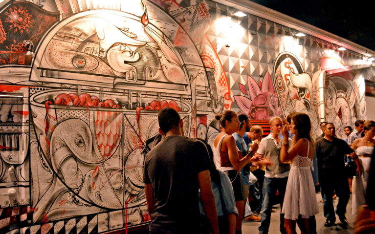 People Standing in Front of a Large Mural During Wynwood Art Walk Miami :: I've Been Bit! Travel Blog