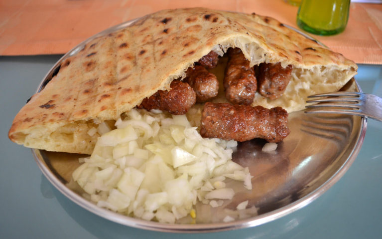 Ćevapi with onions at a cafe in Sarajevo :: I've Been Bit! Travel Blog