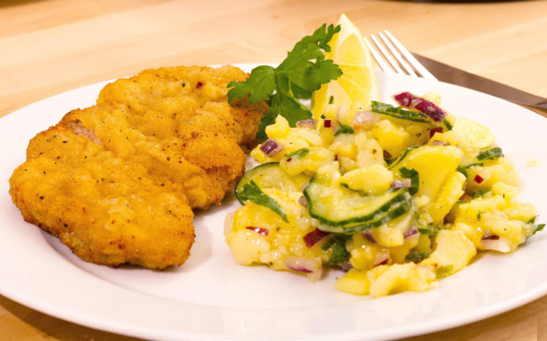 Traditional Wiener Schnitzel with Potato Salad on a White Plate :: I've Been Bit! Travel Blog