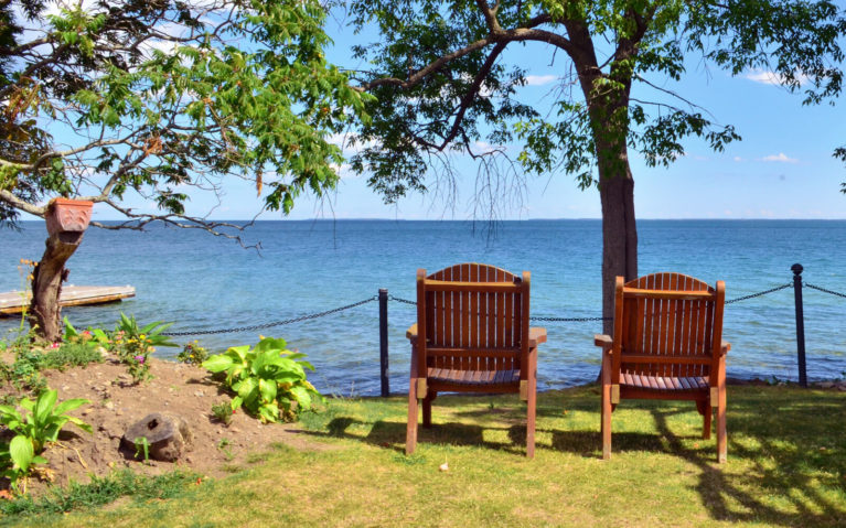 Two Outdoor Chairs Along the Beautiful Shoreline of Prince Edward County Ontario :: I've Been Bit! Travel Blog