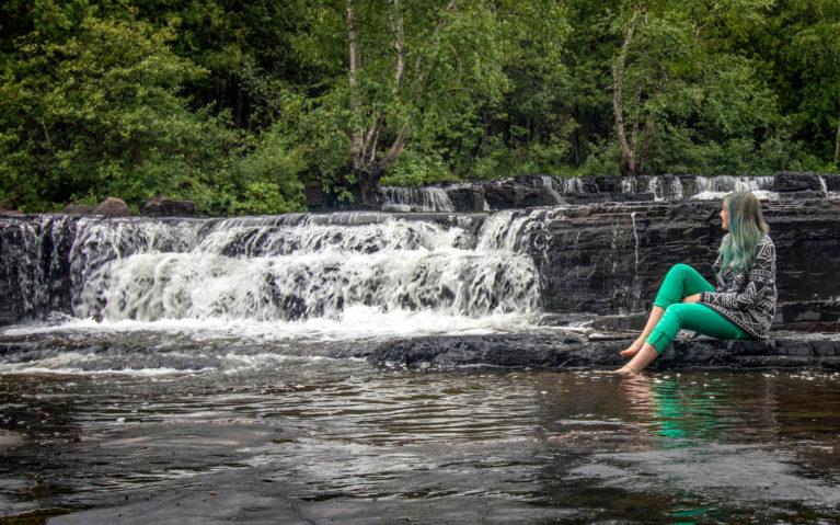 Lindsay Sitting Beside One of the Crests of Trowbridge Falls in Cascades Conservation Area :: I've Been Bit! Travel Blog
