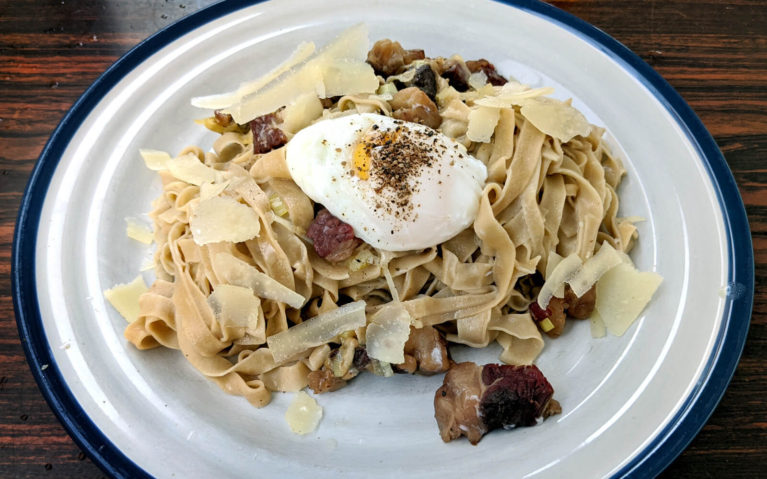 Flat Noodles on a White Plate with Beef, an Egg and Parmesan Shavings :: I've Been Bit! Travel Blog